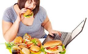 fat woman eating at desk
