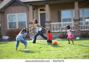 mother with kids in yard