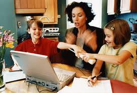 mom with kids and laptop