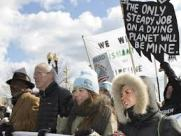 The irony of freezing, Global Warming, protesters is not lost on the observer of this picture.