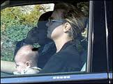 Singer Brittany Spears drives with infant son on her lap.