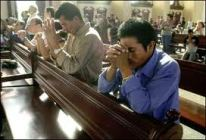 fathers praying in church