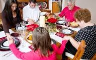 Christmas Dinner  - Family in Prayer