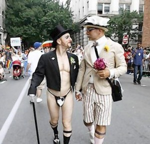 A couple march dressed as bride and groom during the Gay Pride Parade in New York