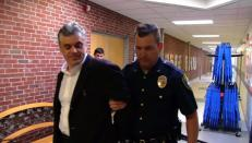 Mr. Baer handcuffed and under arrest.