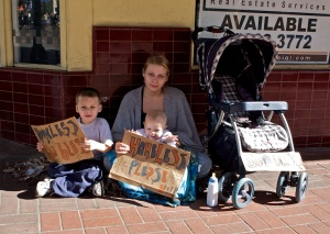 Homeless woman and children