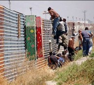 Illegals jumping border fence