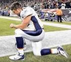 kneeling in prayer Tim Tebow